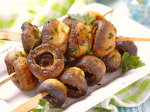 Grilled mushroom with parsley and garlic Royalty Free Stock Images
