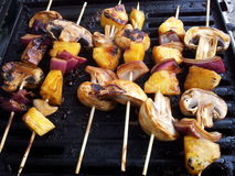 Grilled Mushroom, Red Onion, and Pineapple Kabobs royalty free stock photos