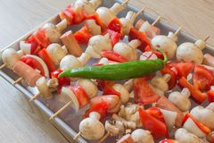 Grilled Mushroom, sausages, tomatoes, red and green pepper Recipe on Skewers | Free Delicious. Healthy eating royalty free stock image