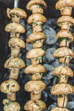 Grilled mushrooms cooked in a brazier, top view, close-up Stock Photography