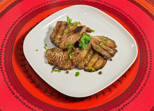 Grilled mushrooms with parsley,paprika and few grains of black pepper. Royalty Free Stock Photo