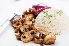 Grilled mushrooms with rice Stock Images