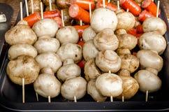 Grilled mushrooms on skewers. Porcini mushrooms grilled mushrooms on skewers. Street festival food Stock Images
