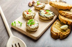 Grilled mushrooms stuffed cheese and chilli Stock Image