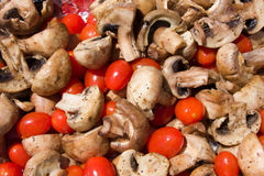 Grilled mushrooms and tomatoes. A background of grilled mushrooms and cherry tomatoes Stock Photography