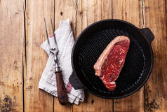Grilled New York steak on grill pan Royalty Free Stock Photos