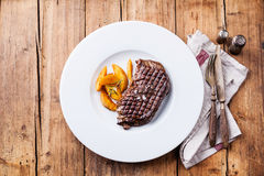 Grilled New York steak with potato wedges Royalty Free Stock Photography