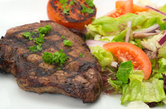 Grilled New York steak and salad Royalty Free Stock Photos