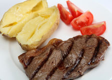 Grilled New York steak with veg Stock Images