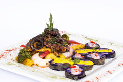 Grilled Octopus, gourmet dish from Peru. Served with purple potatoes (nativa) Stock Photo