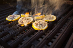 Grilled octopus during a Hawaiian sunset. Octopus on the grill for upcoming Hawaiian dinner stock photo