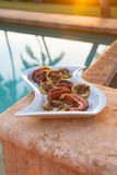 Grilled octopus during a Hawaiian sunset. Octopus on the grill for upcoming Hawaiian dinner royalty free stock photography