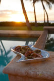 Grilled octopus during a Hawaiian sunset. Octopus on the grill for upcoming Hawaiian dinner Royalty Free Stock Images