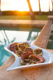 Grilled octopus during a Hawaiian sunset. Octopus on the grill for upcoming Hawaiian dinner Royalty Free Stock Image
