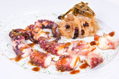 Grilled octopus sauce with sea lettuce. Stock Image