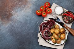 Grilled octopus with small potatoes stock photography