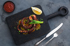 Grilled octopus with vegetables Royalty Free Stock Images
