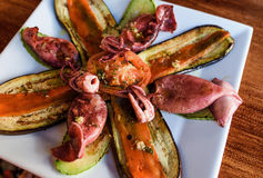 Grilled octopus with vegetables Stock Photos