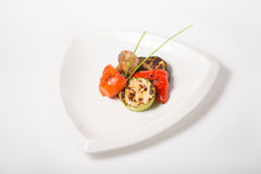 Grilled oily vegetables. Served on a white plate Stock Photo