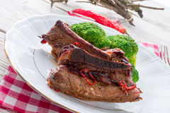Grilled ones rib with broccoli Stock Images