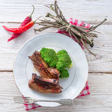 Grilled ones rib with broccoli Stock Photos