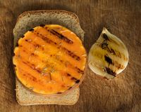 Grilled onion and pumpkin slice. With herbs royalty free stock photography