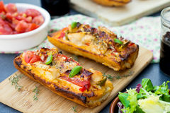 Grilled open faced sandwich with tomato, olives, cheese and chic. Grilled open faced sandwich tartine with tomato, olives, cheese and chicken Royalty Free Stock Photo