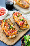 Grilled open faced sandwich with tomato, olives, cheese and chic. Grilled open faced sandwich tartine with tomato, olives, cheese and chicken Royalty Free Stock Images