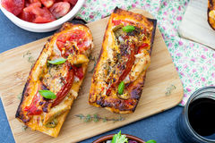 Grilled open faced sandwich with tomato, olives, cheese and chic. Grilled open faced sandwich tartine with tomato, olives, cheese and chicken Stock Photo