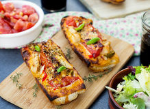 Grilled open faced sandwich with tomato, olives, cheese and chic. Grilled open faced sandwich tartine with tomato, olives, cheese and chicken Royalty Free Stock Image