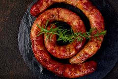 Grilled Or Roasted Spiral Pork Sausages Stock Images