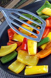 grilled organic peppers on a pan Stock Photography