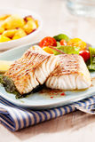 Grilled or oven-baked pollock fillets Royalty Free Stock Image