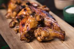 Texas style chicken wings. Grilled or oven roasted chicken wings glazed with barbecue sauce Royalty Free Stock Photography