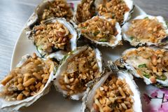 Grilled Oysters With oil, green onion, roasted peanut Stock Photos