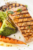 Grilled Pacific Coast salmon with grilled vegetables. Organic grilled Pacific Coast salmon with grilled vegetables Royalty Free Stock Image
