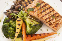 Grilled Pacific Coast salmon with grilled vegetables. Organic grilled Pacific Coast salmon with grilled vegetables Stock Images