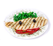Grilled pangasius fillet on plate. Royalty Free Stock Photography