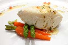 Grilled Pangasius fish steak,  on a white plate Stock Images