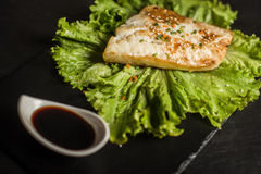 Grilled pangasius with sauce. Seafood. Fish dish. Restaurant Royalty Free Stock Images