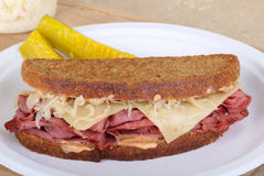 Grilled Pastrami Sandwich. Grilled pastrami and cheese sandwich on a plate Stock Images