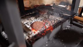 Grilled patties for burgers on charcoal. stock photo