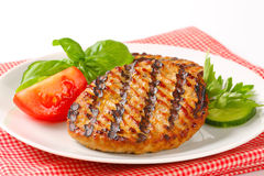 Grilled patties Stock Images