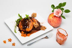 Grilled peach. With chocolate, nuts and liquor Stock Image