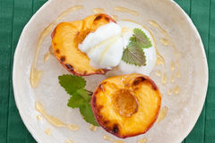 Grilled peach with honey Royalty Free Stock Photography