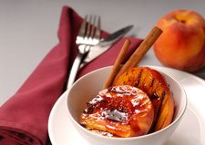 Grilled peaches with cinnamon Stock Images