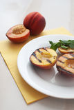 Grilled peaches dessert Stock Image