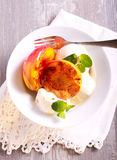 Grilled peaches and ice cream dessert. On plate Stock Photography