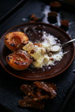 Grilled peaches, ice cream, ganache and almonds royalty free stock photos