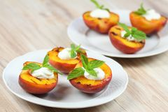 Grilled peaches and mascarpone with mint Royalty Free Stock Image
